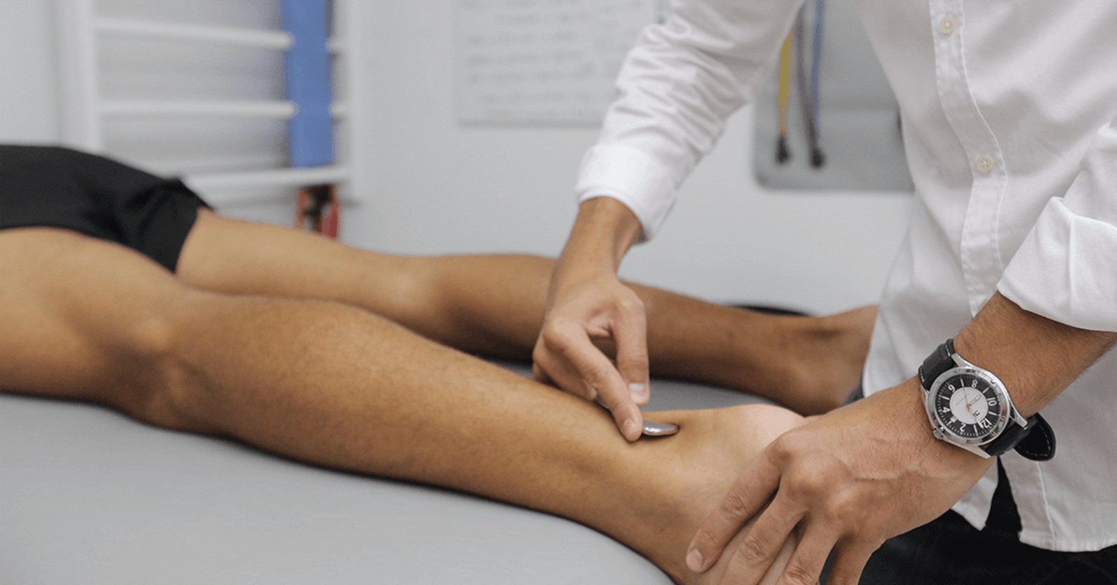 Doctor treating patient's ankle