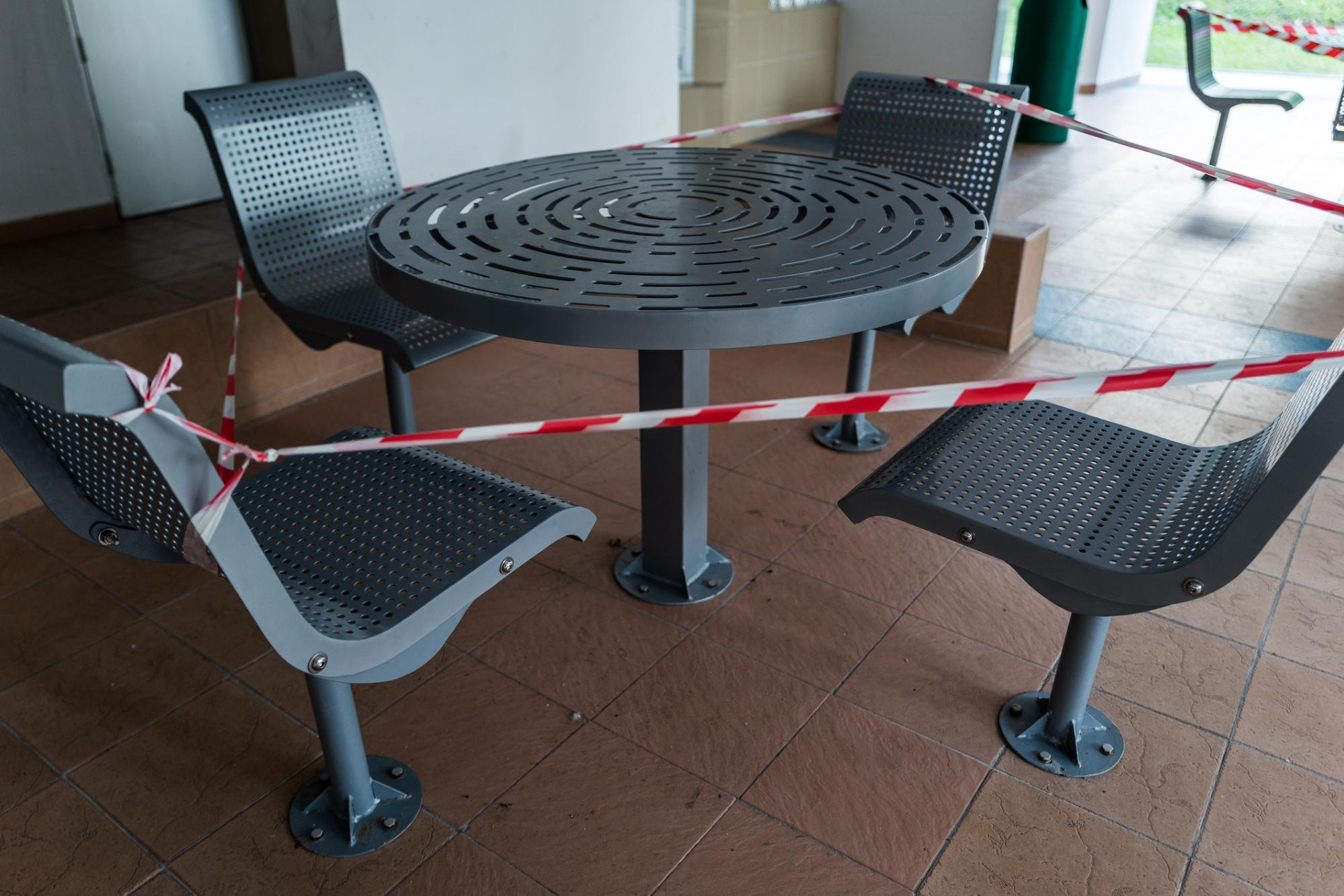 Photo of barricaded seats at a void deck